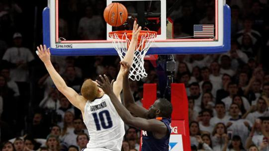 Villanova's Donte DiVincenzo. center, puts back a shot by teammate Josh Hart, bottom, for the winning basket with Virginia's Marial Shayok, right and Ty Jerome , left, defending during the second half of an NCAA college basketball game, Sunday, Jan. 29, 2017, in Philadelphia. (AP Photo/Chris Szagola)